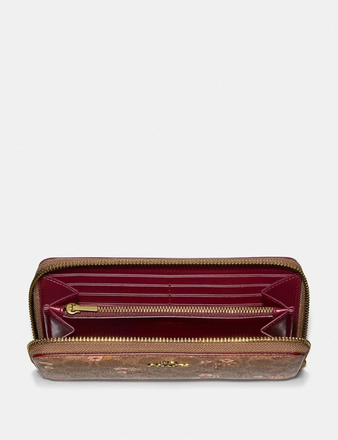 Coach Accordion Zip Wallet in Signature Canvas With Floral Bow Print Tan/Brass Women Collection Signature Alternate View 1