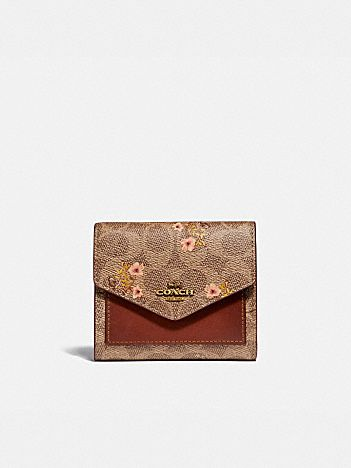 small wallet in signature canvas with floral bow print