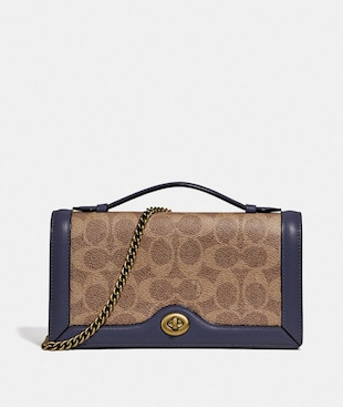 RILEY CHAIN CLUTCH IN COLORBLOCK SIGNATURE CANVAS