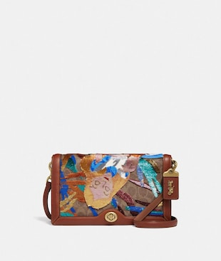 RILEY DISNEY X COACH EXCLUSIF AVEC GRAPHISME ALICE À ORNEMENTS