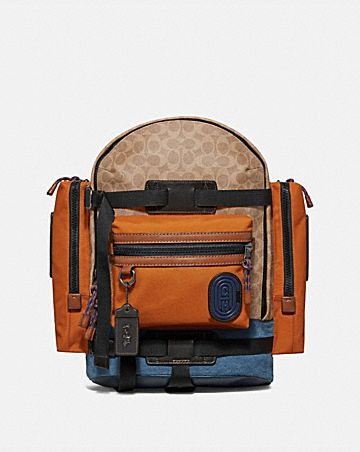 8de8fb309904 ridge backpack in signature canvas with coach.