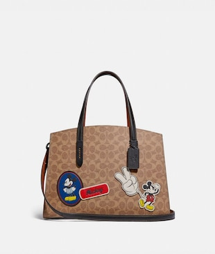 DISNEY X COACH CHARLIE CARRYALL IN SIGNATURE CANVAS WITH PATCHES