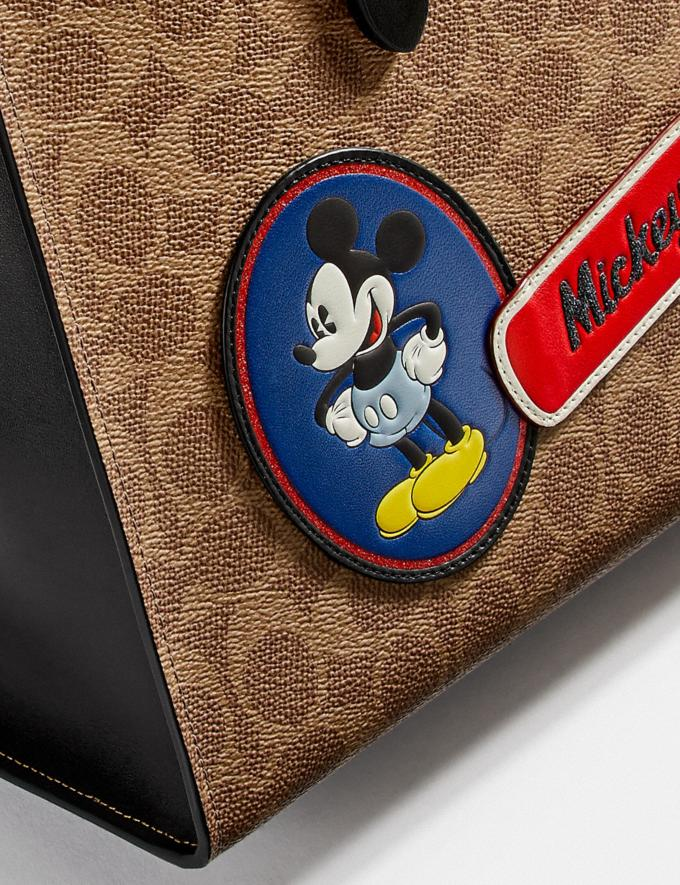 Coach Disney X Coach Charlie Carryall in Signature Canvas With Patches Pewter/Tan Black Multi New Women's New Arrivals View All Alternate View 3