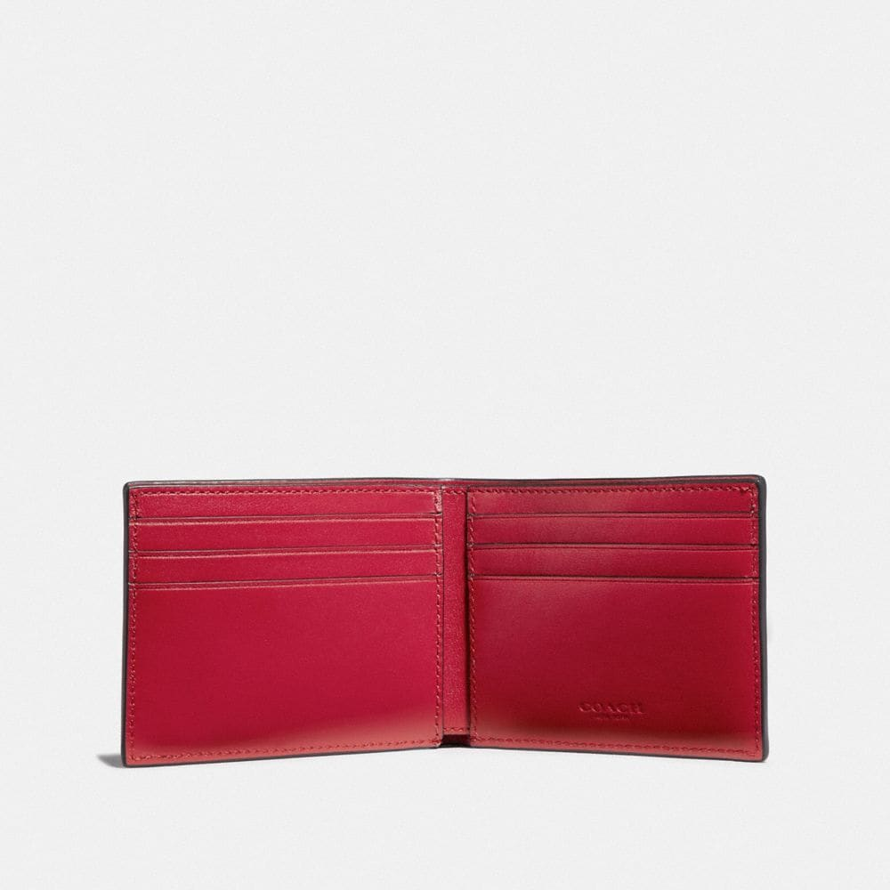 Coach Slim Billfold Wallet in Signature Canvas With Coach Patch Alternate View 1
