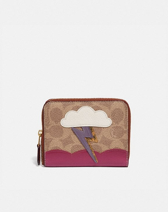 Coach SMALL ZIP AROUND WALLET IN SIGNATURE CANVAS WITH LIGHTNING CLOUD APPLIQUE AND SNAKESKIN DETAIL