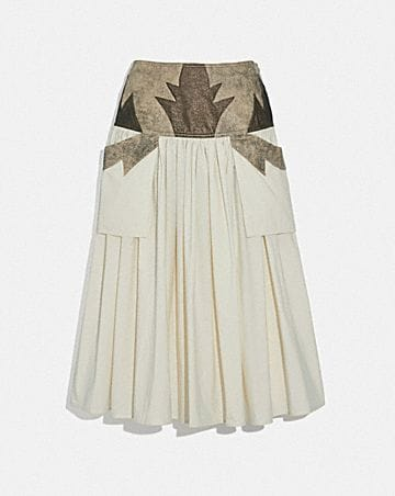 PLEATED SKIRT WITH LEATHER DETAIL