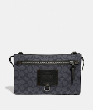 RIVINGTON CONVERTIBLE POUCH IN SIGNATURE CANVAS