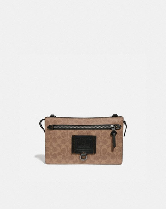 Coach RIVINGTON CONVERTIBLE POUCH IN SIGNATURE CANVAS