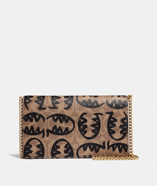 CALLIE FOLDOVER CHAIN CLUTCH IN SIGNATURE CANVAS WITH REXY BY GUANG YU