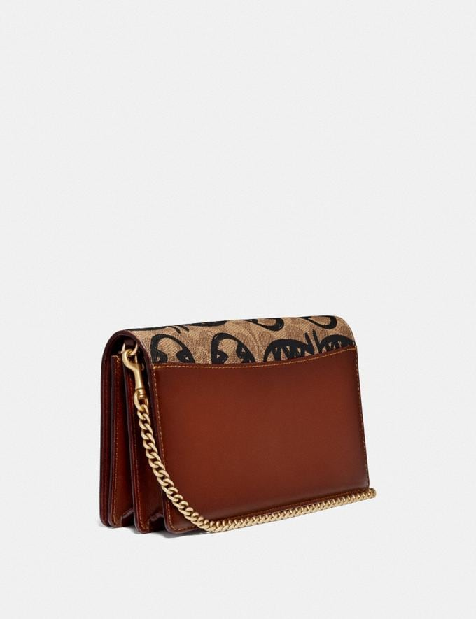 Coach Callie Foldover Chain Clutch in Signature Canvas With Rexy by Guang Yu Tan/Rust/Brass Women Small Leather Goods Crossbody Wallets Alternate View 1