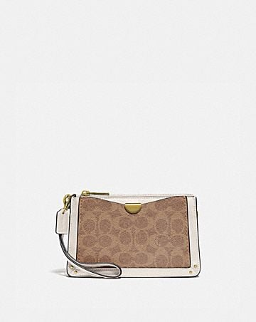DREAMER WRISTLET IN SIGNATURE CANVAS