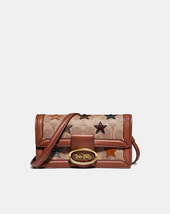 Coach RILEY CONVERTIBLE BELT BAG IN SIGNATURE CANVAS WITH STAR APPLIQUE AND SNAKESKIN DETAIL