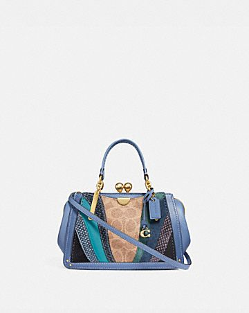 KISSLOCK DREAMER 21 IN SIGNATURE CANVAS WITH WAVE PATCHWORK AND SNAKESKIN DETAIL
