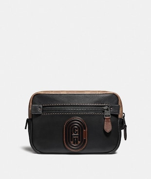ACADEMY L-PACK WITH SIGNATURE CANVAS BLOCKING AND COACH PATCH