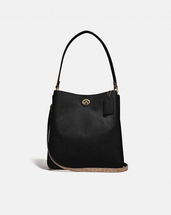 Coach CHARLIE BUCKET BAG WITH SIGNATURE CANVAS BLOCKING