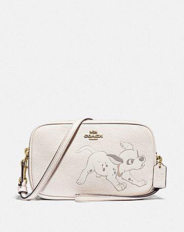 disney x coach sadie crossbody clutch with dalmatian motif