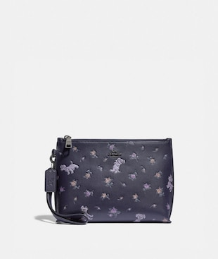 DISNEY X COACH CHARLIE POUCH WITH MIXED DALMATIAN PRINT