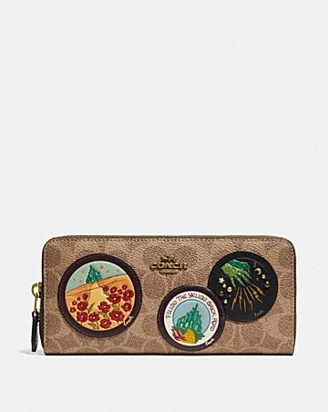 wizard of oz boxed slim accordion zip wallet in signature canvas with patches