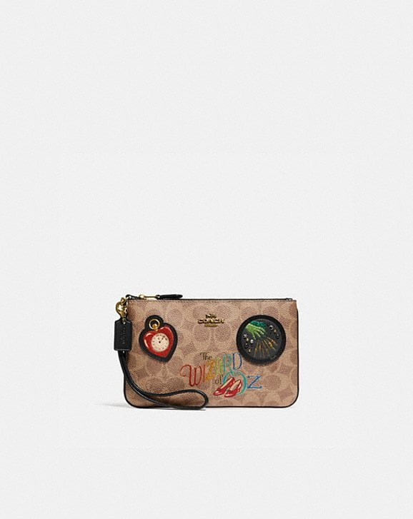 Coach WIZARD OF OZ BOXED SMALL WRISTLET IN SIGNATURE CANVAS WITH PATCHES