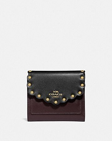 small wallet in colorblock with scallop rivets