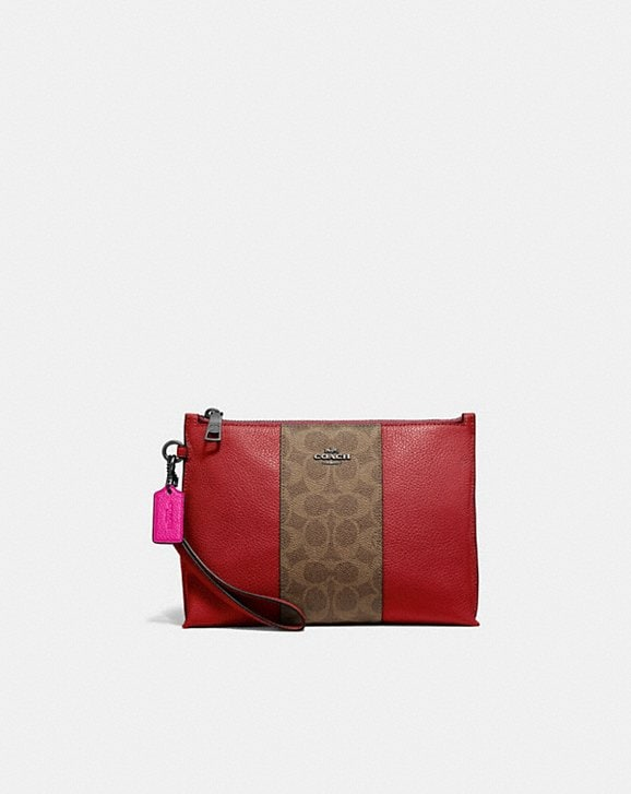 Coach CHARLIE POUCH WITH SIGNATURE CANVAS BLOCKING