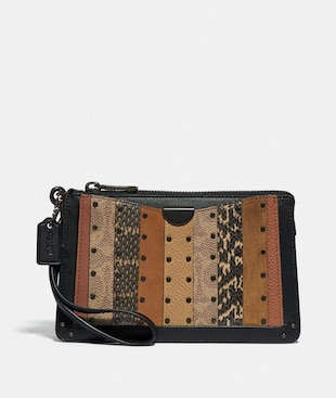 DREAMER WRISTLET WITH SIGNATURE CANVAS PATCHWORK STRIPES AND SNAKESKIN DETAIL