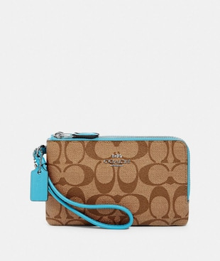 DOUBLE CORNER ZIP WRISTLET IN SIGNATURE CANVAS