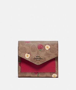 SMALL WALLET IN SIGNATURE CANVAS WITH SCATTERED APPLE PRINT