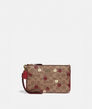 SMALL WRISTLET IN SIGNATURE CANVAS WITH SCATTERED APPLE PRINT