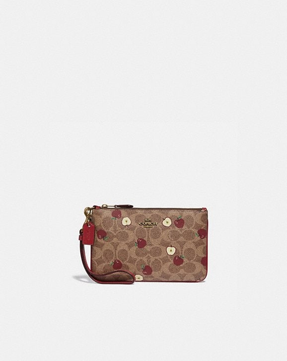 Coach SMALL WRISTLET IN SIGNATURE CANVAS WITH SCATTERED APPLE PRINT