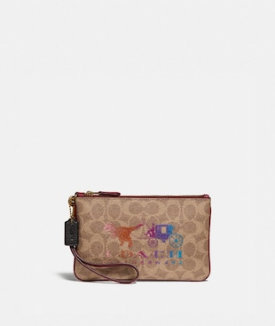 SMALL WRISTLET IN SIGNATURE CANVAS WITH REXY AND CARRIAGE
