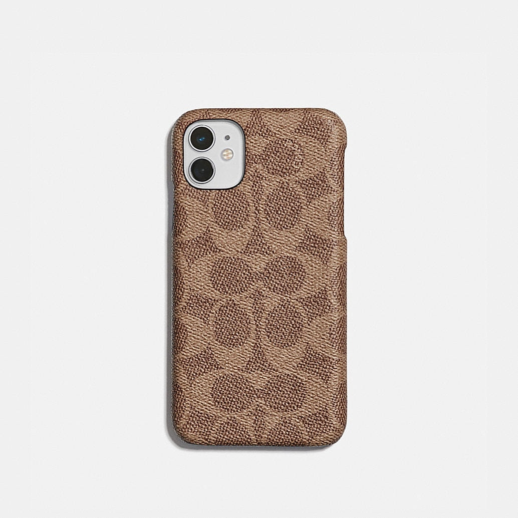 iphone-11-case-in-signature-canvas by coach