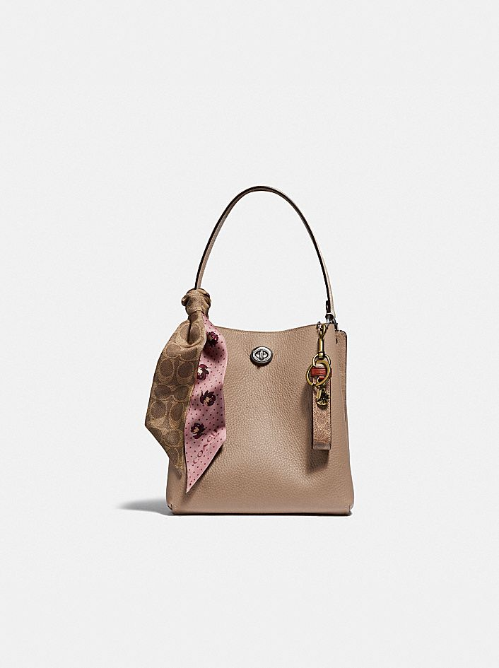 CHARLIE BUCKET BAG 21 IN BLOCKED SIGNATURE CANVAS