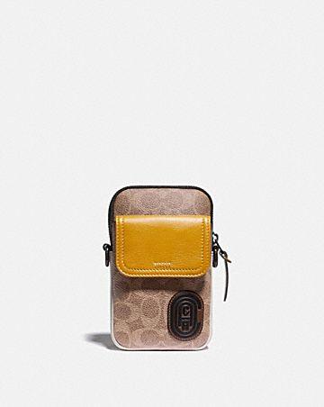 pochette convertible pacer en toile exclusive color block avec pièce écusson de coach