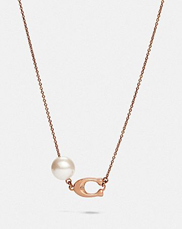 collier de perle avec signature sculptée