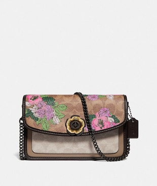 PARKER CROSSBODY IN SIGNATURE CANVAS WITH BLOSSOM PRINT