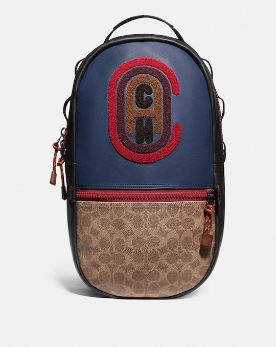 PACER BACKPACK IN COLORBLOCK SIGNATURE CANVAS WITH COACH PATCH
