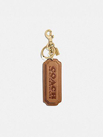 coach badge bag charm