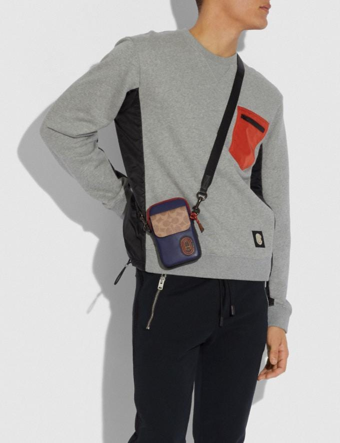 Coach Pacer Convertible Pouch in Colorblock Signature Canvas With Coach Patch True Navy Multi Men Edits Travel Alternate View 1