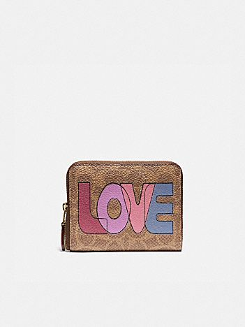 small zip around wallet in signature canvas with love print