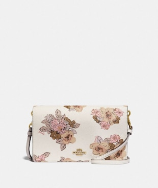 HAYDEN FOLDOVER CROSSBODY CLUTCH WITH FLORAL BOUQUET PRINT