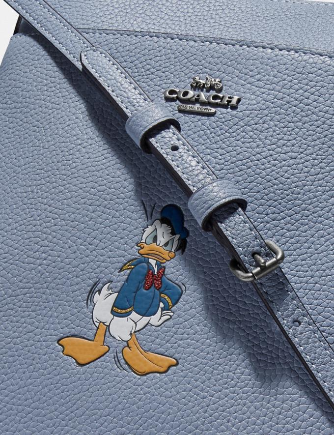 Coach Disney X Coach Kitt Messenger Crossbody With Donald Duck Motif Light Nickel/Bluebell New Featured Disney X Coach Alternate View 3