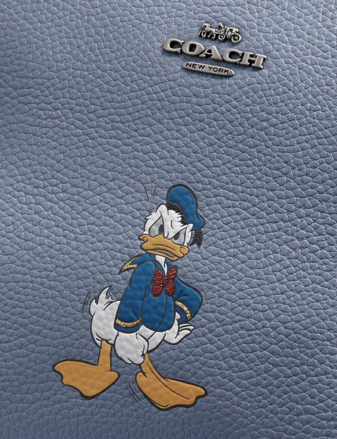 Coach Disney X Coach Charlie Pouch With Donald Duck Motif Light Nickel/Bluebell New Featured Disney X Coach Alternate View 1