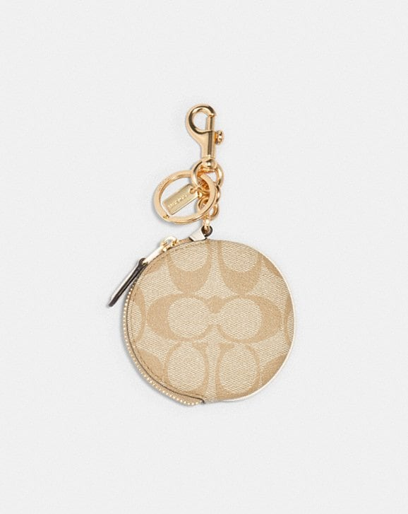 Coach CIRCULAR COIN POUCH BAG CHARM IN SIGNATURE CANVAS