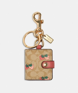 PICTURE FRAME BAG CHARM IN SIGNATURE CANVAS WITH STRAWBERRY PRINT