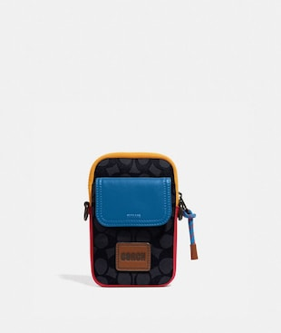 PACER CONVERTIBLE POUCH IN COLORBLOCK SIGNATURE CANVAS WITH COACH PATCH