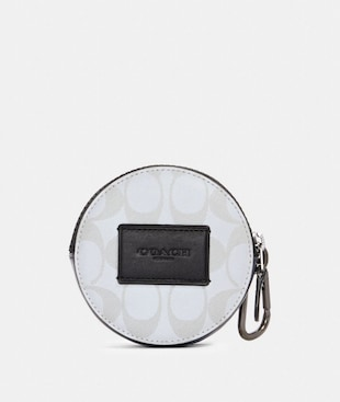 ROUND HYBRID POUCH IN REFLECTIVE SIGNATURE CANVAS