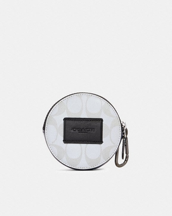 Coach ROUND HYBRID POUCH IN REFLECTIVE SIGNATURE CANVAS