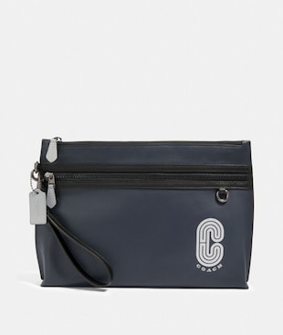 SPORTY CARRY ALL POUCH WITH REFLECTIVE COACH PATCH