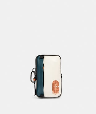 NORTH/SOUTH HYBRID POUCH IN COLORBLOCK WITH COACH PATCH